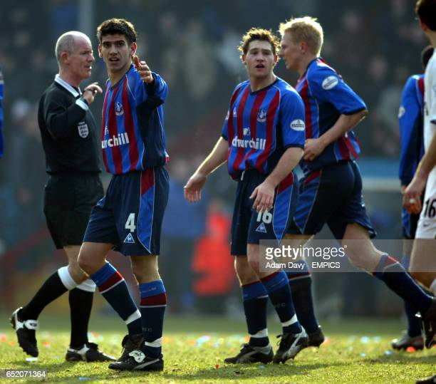 Crystal Palace's Danny Butterfield and Tommy Black argue with referee Dermot Gallagher after the ball appeared to go over the line