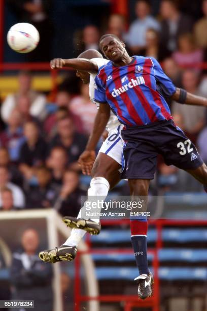 Crystal Palace's Darren Powell and Gillingham's Guy Ipoua both jump for the ball