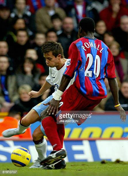 Crystal Palace's Darren Powell defends against Aston Villa's Gereth Barry during Premiership football 03 January 2005 at Selhurst Park in London. AFP...