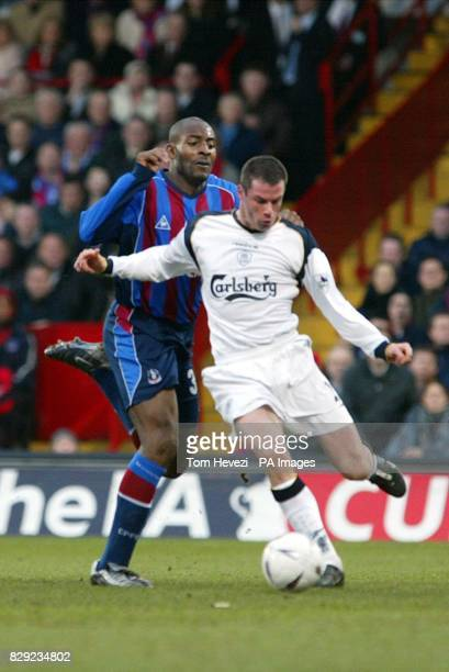 Crystal Palace's Dele Adebola and Liverpool's Jamie Carragher during their FA Cup Fourth Round match at Selhurst Park London THIS PICTURE CAN ONLY BE...