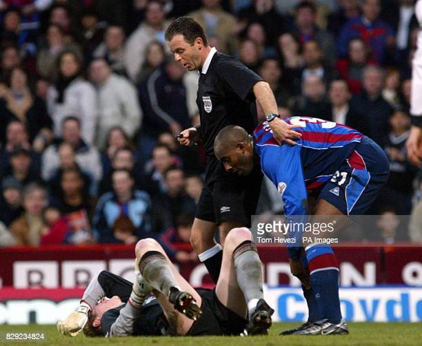 Crystal Palace's Dele Adebola and match referee Mr R Styles try to help Liverpool's Chris Kirkland before he is stretchered off the pitch and taken...