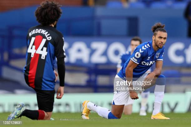 Crystal Palace's Dutch defender Jairo Riedewald and Everton's English striker Dominic Calvert-Lewin 'take a knee' in support of the No Room For...