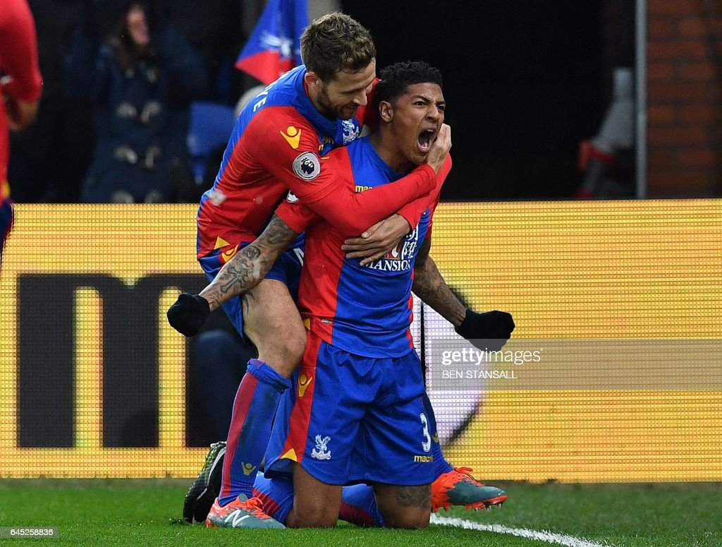 Crystal Palace's Dutch defender Patrick van Aanholt (R) celebrates scoring his team's first goal during the English Premier League football match between Crystal Palace and Middlesbrough at Selhurst Park in south London on February 25, 2017. / AFP / Ben STANSALL / RESTRICTED TO EDITORIAL USE. No use with unauthorized audio, video, data, fixture lists, club/league logos or 'live' services. Online in-match use limited to 75 images, no video emulation. No use in betting, games or single club/league/player publications. /