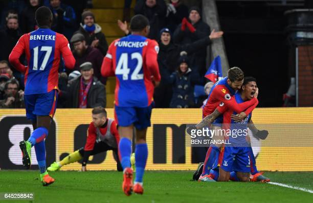 Crystal Palace's Dutch defender Patrick van Aanholt celebrates scoring his team's first goal during the English Premier League football match between...