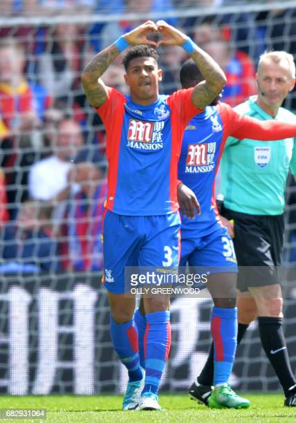 Crystal Palace's Dutch defender Patrick van Aanholt celebrates scoring the fourth goal during the English Premier League football match between...