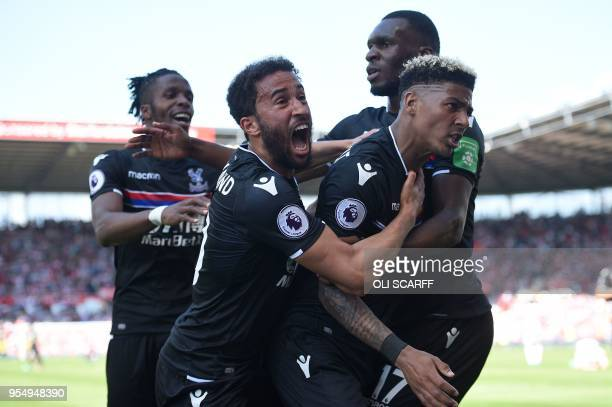 Crystal Palace's Dutch defender Patrick van Aanholt celebrates scoring his team's second goal with Crystal Palace's Ivorian striker Wilfried Zaha...