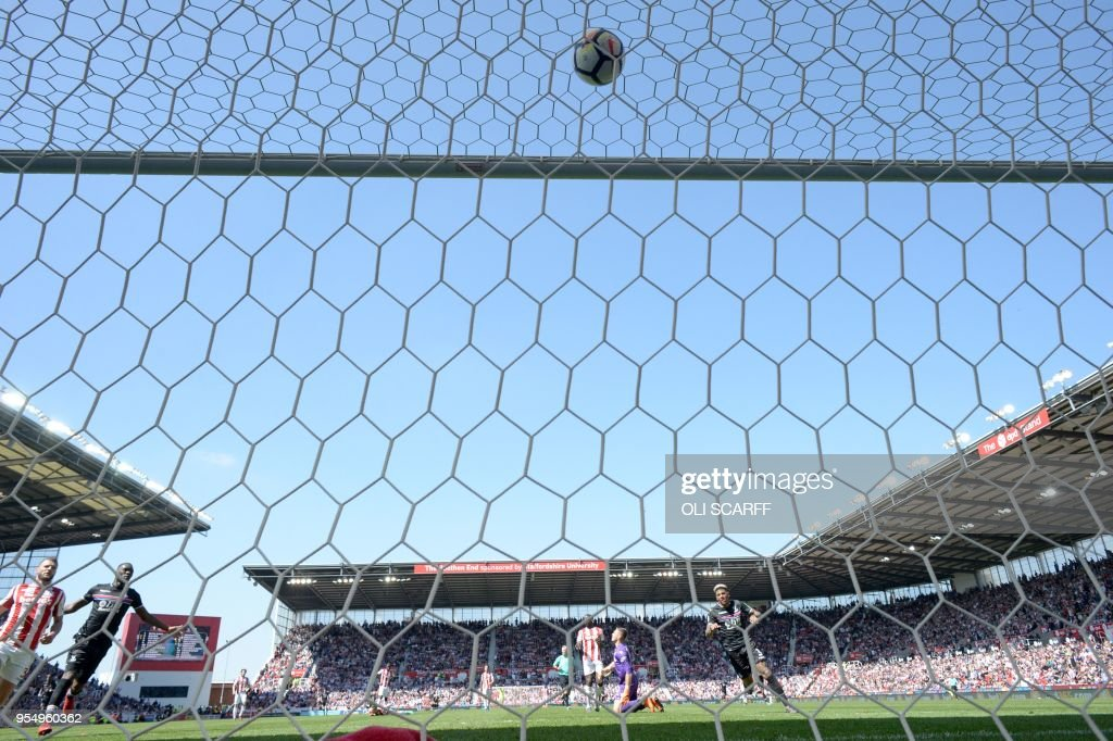Crystal Palace's Dutch defender Patrick van Aanholt (R) celebrates scoring his team's second goal during the English Premier League football match between Stoke City and Crystal Palace at the Bet365 Stadium in Stoke-on-Trent, central England on May 5, 2018. (Photo by OLI SCARFF / AFP) / RESTRICTED TO EDITORIAL USE. No use with unauthorized audio, video, data, fixture lists, club/league logos or 'live' services. Online in-match use limited to 75 images, no video emulation. No use in betting, games or single club/league/player publications. /