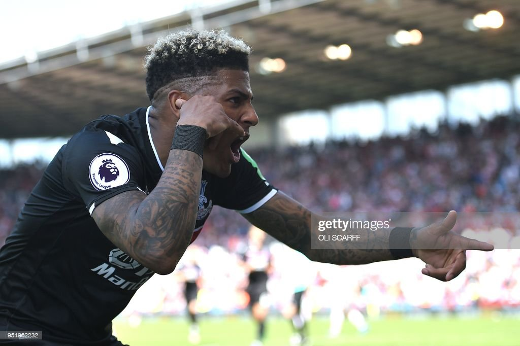 Crystal Palace's Dutch defender Patrick van Aanholt celebrates scoring his team's second goal during the English Premier League football match between Stoke City and Crystal Palace at the Bet365 Stadium in Stoke-on-Trent, central England on May 5, 2018. - Crystal Palace won the match 2-1. (Photo by Oli SCARFF / AFP) / RESTRICTED TO EDITORIAL USE. No use with unauthorized audio, video, data, fixture lists, club/league logos or 'live' services. Online in-match use limited to 75 images, no video emulation. No use in betting, games or single club/league/player publications. /