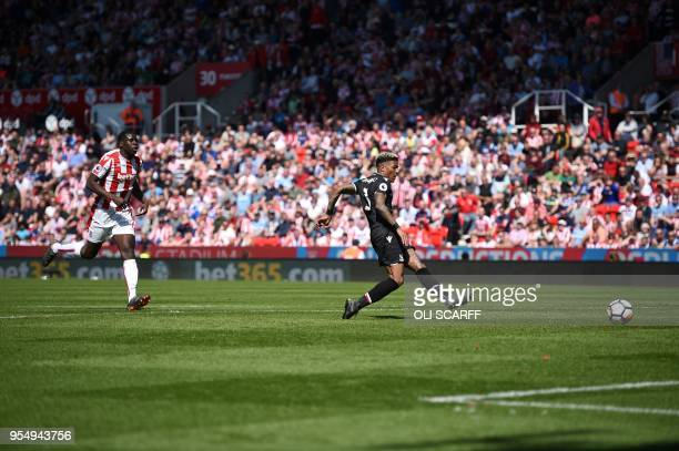 Crystal Palace's Dutch defender Patrick van Aanholt scores his team's second goal during the English Premier League football match between Stoke City...