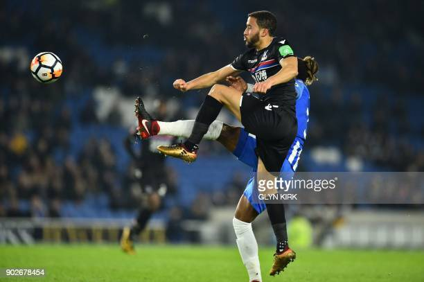Crystal Palace's Dutch defender Patrick van Aanholt vies with Brighton's Israeli striker Tomer Hemed during the English FA Cup third round football...