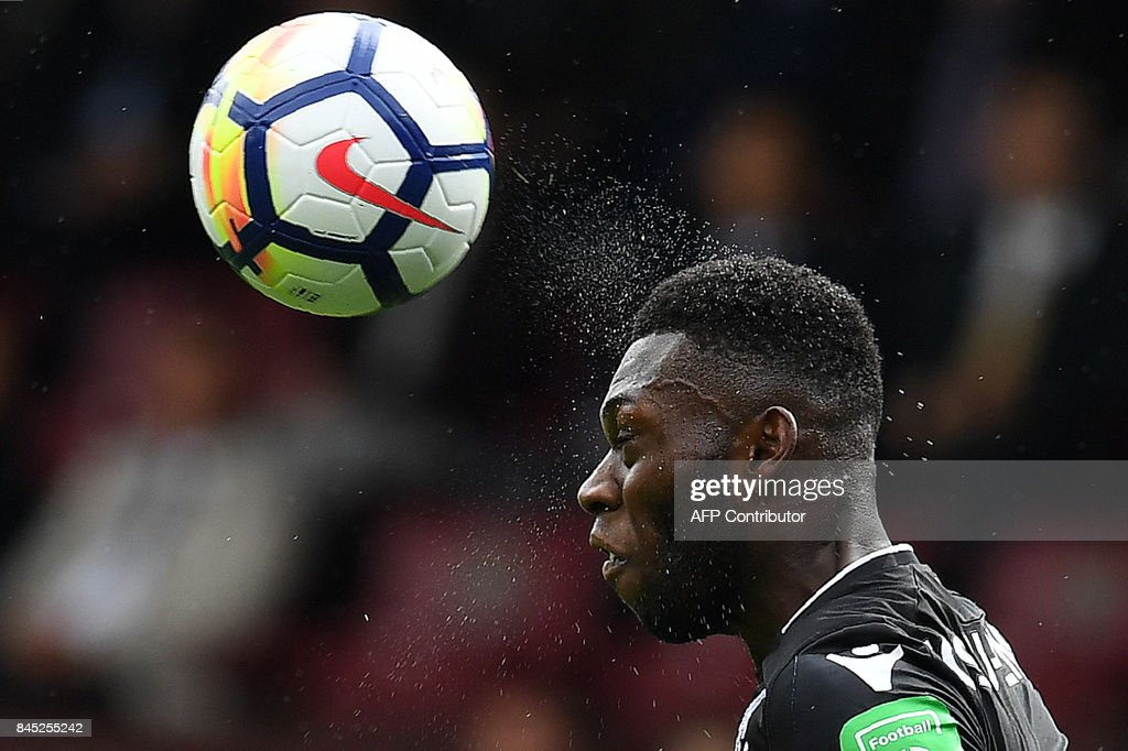 TOPSHOT - Crystal Palace's Dutch defender Timothy Fosu-Mensah heads the ball during the English Premier League football match between Burnley and Crystal Palace at Turf Moor in Burnley, north west England on September 10, 2017. / AFP PHOTO / Paul ELLIS / RESTRICTED TO EDITORIAL USE. No use with unauthorized audio, video, data, fixture lists, club/league logos or 'live' services. Online in-match use limited to 75 images, no video emulation. No use in betting, games or single club/league/player publications. /