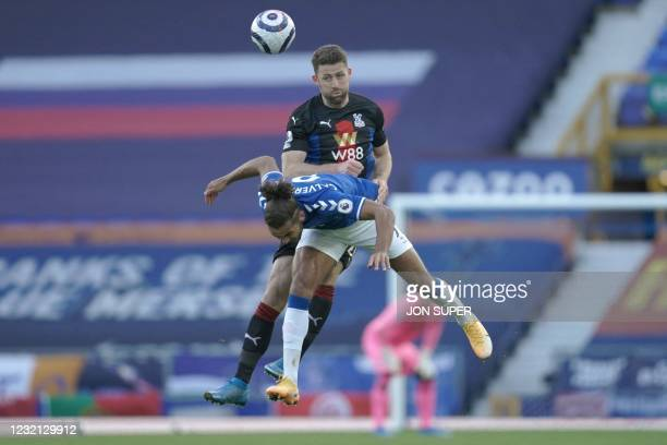 Crystal Palace's English defender Gary Cahill and Everton's English striker Dominic Calvert-Lewin jump for a header during the English Premier League...