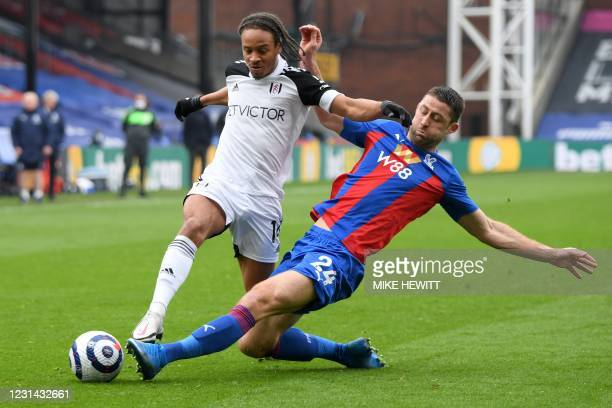 Crystal Palace's English defender Gary Cahill tackles Fulham's Jamaican striker Bobby Decordova-Reid during the English Premier League football match...