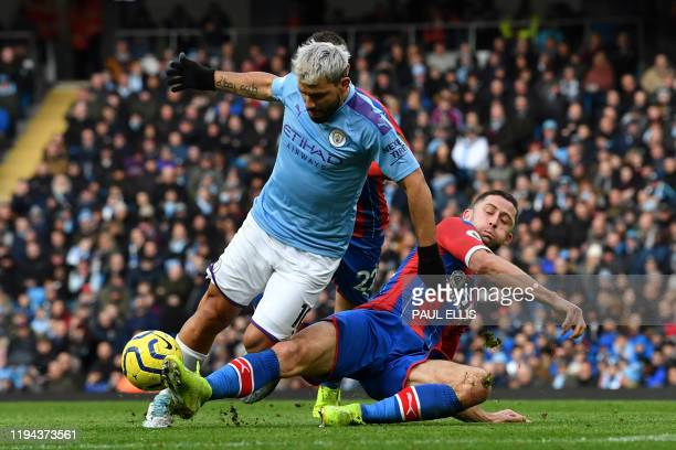 Crystal Palace's English defender Gary Cahill tackles Manchester City's Argentinian striker Sergio Aguero during the English Premier League football...