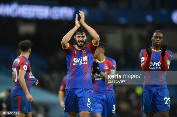 Crystal Palace's English defender James Tomkins celebrates after the final whistle during the English Premier League football match between...