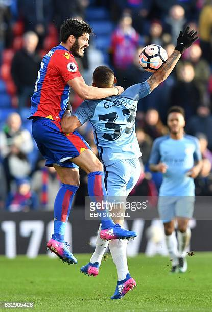 Crystal Palace's English defender James Tomkins challenges Manchester City's Brazilian striker Gabriel Jesus and concedes a free kick during the...