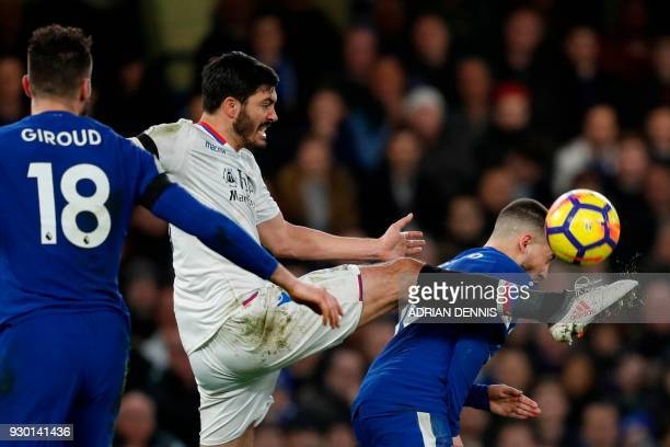 Crystal Palace's English defender James Tomkins plays the ball between Chelsea's French attacker Olivier Giroud and Chelsea's Belgian midfielder Eden...