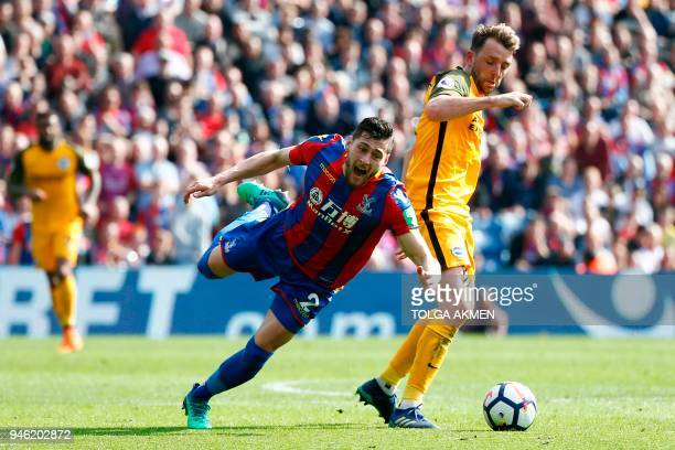 Crystal Palace's English defender Joel Ward goes down in a challenge with Brighton's English midfielder Dale Stephens during the English Premier...