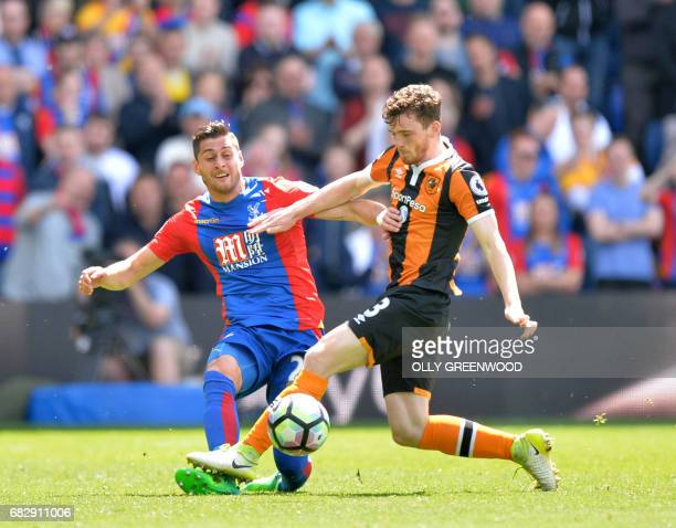 Crystal Palace's English defender Joel Ward vies with Hull City's Scottish defender Andrew Robertson during the English Premier League football match...