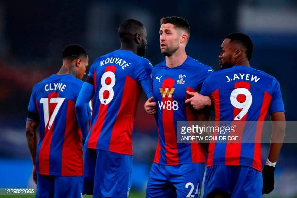 Crystal Palace's English defender Nathaniel Clyne Crystal Palace's Senegalese midfielder Cheikhou Kouyate Crystal Palace's English defender Gary...
