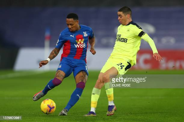 Crystal Palace's English defender Nathaniel Clyne vies with Newcastle United's Paraguayan midfielder Miguel Almiron during the English Premier League...