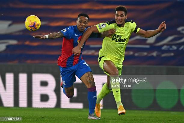 Crystal Palace's English defender Nathaniel Clyne vies with Newcastle United's Brazilian striker Joelinton during the English Premier League football...