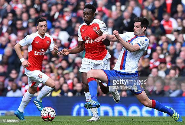 Crystal Palace's English defender Scott Dann challenges Arsenal's English striker Danny Welbeck conceding a freekick during the English Premier...