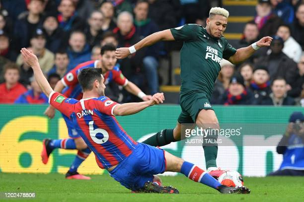 Crystal Palace's English defender Scott Dann vies with Newcastle United's English defender Jamaal Lascelles during the English Premier League...