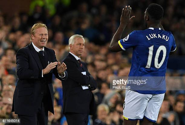 Crystal Palace's English manager Alan Pardew reacts as Everton's Belgian striker Romelu Lukaku celebrates scoring his team's first goal with...