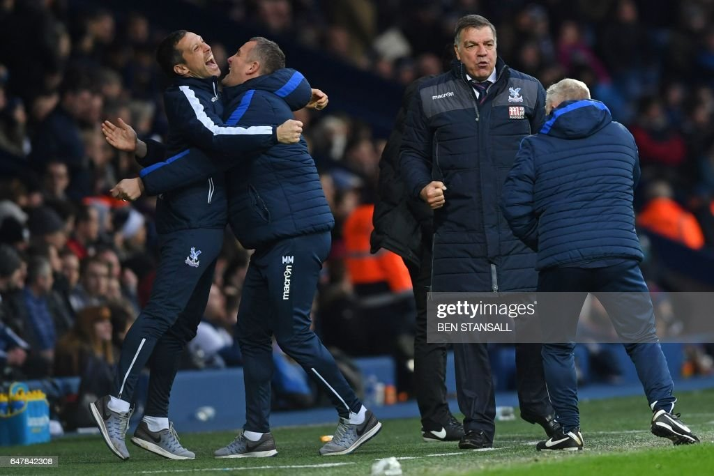Crystal Palace's English manager Sam Allardyce (2nd R) and assistants celebrate their second goal during the English Premier League football match between West Bromwich Albion and Crystal Palace at The Hawthorns stadium in West Bromwich, central England, on March 4, 2017. PHOTO / Ben STANSALL / RESTRICTED TO EDITORIAL USE. No use with unauthorized audio, video, data, fixture lists, club/league logos or 'live' services. Online in-match use limited to 75 images, no video emulation. No use in betting, games or single club/league/player publications. /