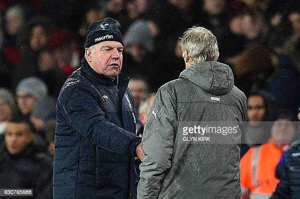 Crystal Palace's English manager Sam Allardyce shakes hands with Arsenal's French manager Arsene Wenger following the English Premier League football...