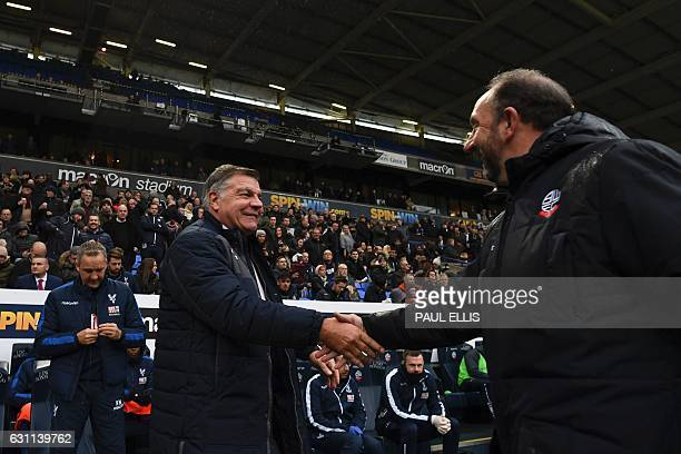 Crystal Palace's English manager Sam Allardyce shakes hands with Bolton's First Team Assistant Manager Steve Parkin during the English FA Cup third...