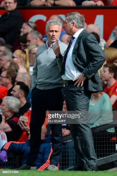 Crystal Palace's English manager Sam Allardyce talks with Manchester United's Portuguese manager Jose Mourinho on the touchline during the English...