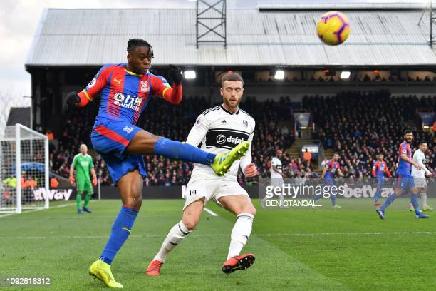Crystal Palace's English midfielder Aaron WanBissaka clears the ball during the English Premier League football match between Crystal Palace and...