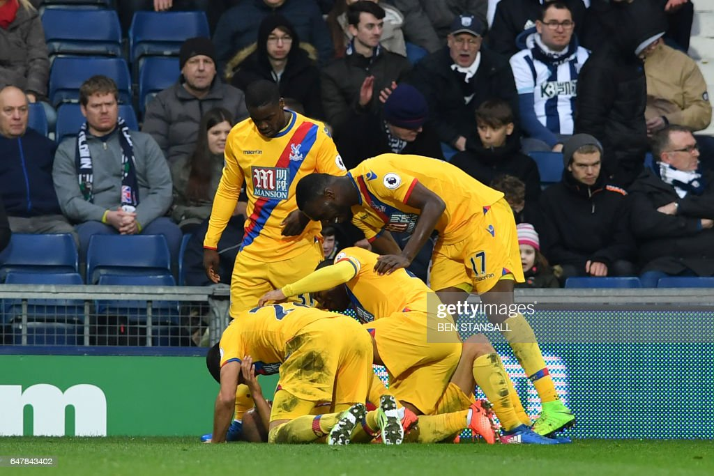 Crystal Palace's English midfielder Andros Townsend is congratulated by teammates after scoring their second goal during the English Premier League football match between West Bromwich Albion and Crystal Palace at The Hawthorns stadium in West Bromwich, central England, on March 4, 2017. PHOTO / Ben STANSALL / RESTRICTED TO EDITORIAL USE. No use with unauthorized audio, video, data, fixture lists, club/league logos or 'live' services. Online in-match use limited to 75 images, no video emulation. No use in betting, games or single club/league/player publications. /