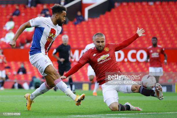 TOPSHOT Crystal Palace's English midfielder Andros Townsend shoots to score the opening goal as Manchester United's English defender Luke Shaw tries...