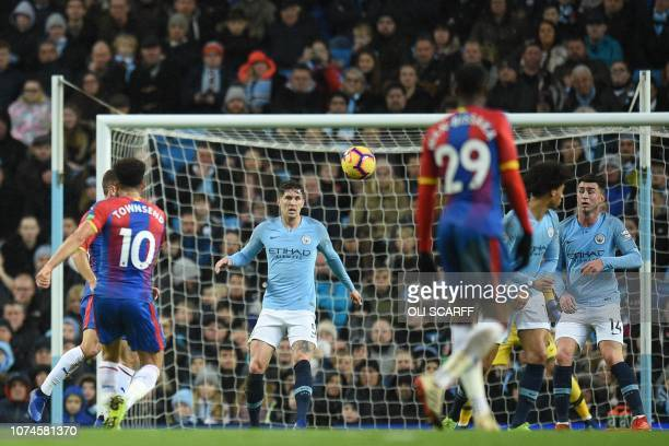 Crystal Palace's English midfielder Andros Townsend strikes the ball to score their second goal to take the lead 12 during the English Premier League...