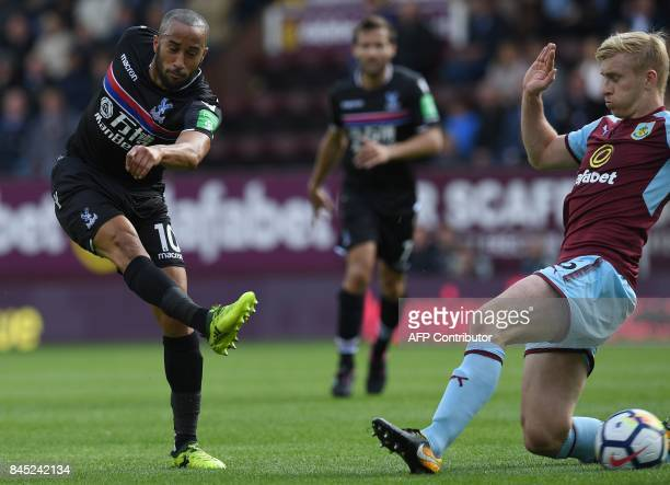 Crystal Palace's English midfielder Andros Townsend takes a shot under pressure from Burnley's English defender Ben Mee during the English Premier...