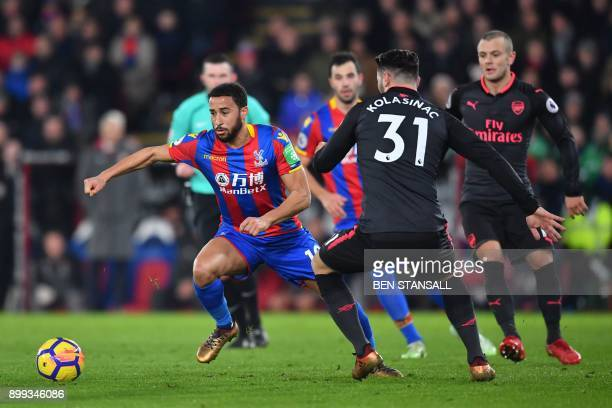 Crystal Palace's English midfielder Andros Townsend vies with Arsenal's Germanborn Bosnian defender Sead Kolasinac during the English Premier League...