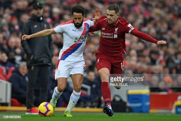 Crystal Palace's English midfielder Andros Townsend vies with Liverpool's English midfielder Jordan Henderson during the English Premier League...