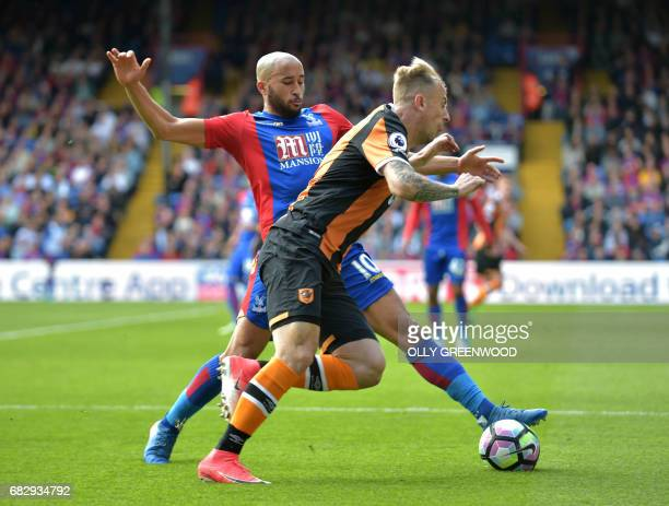 Crystal Palace's English midfielder Andros Townsend vies with Hull City's Polish midfielder Kamil Grosicki during the English Premier League football...