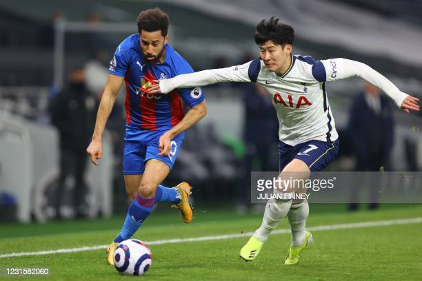 Crystal Palace's English midfielder Andros Townsend vies with Tottenham Hotspur's South Korean striker Son Heung-Min during the English Premier...