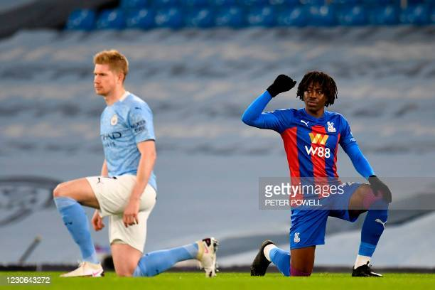 Crystal Palace's English midfielder Eberechi Eze and Manchester City's Belgian midfielder Kevin De Bruyne 'take a knee' in support of the No Room For...