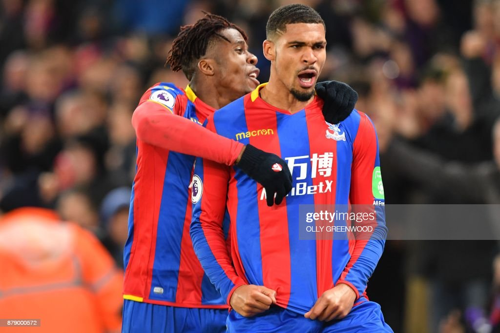Crystal Palace's English midfielder Ruben Loftus-Cheek (R) celebrates scoring their first goal with Crystal Palace's Ivorian striker Wilfried Zaha during the English Premier League football match between Crystal Palace and Stoke City at Selhurst Park in south London on November 25, 2017. / AFP PHOTO / OLLY GREENWOOD / RESTRICTED TO EDITORIAL USE. No use with unauthorized audio, video, data, fixture lists, club/league logos or 'live' services. Online in-match use limited to 75 images, no video emulation. No use in betting, games or single club/league/player publications. /