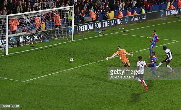 Crystal Palace's English striker Dwight Gayle slots the ball past Liverpool's Belgian goalkeeper Simon Mignolet to score Palace's third equalising...