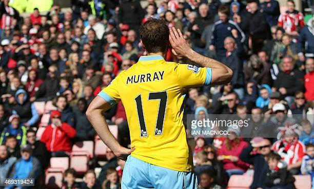 Crystal Palace's English striker Glenn Murray gestures to the crowd after scoring the opening goal during the English Premier League football match...