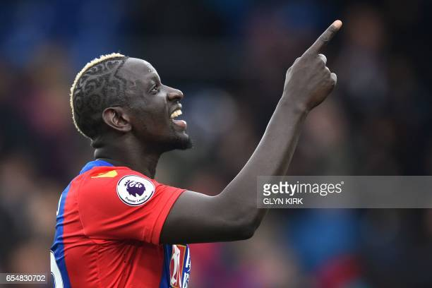 Crystal Palace's French midfielder Mamadou Sakho gestures as he celebrates on the pitch after the English Premier League football match between...