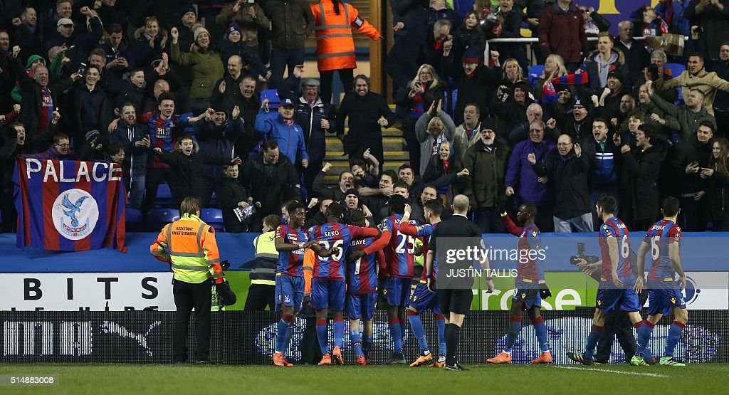 Crystal Palace's French midfielder Yohan Cabaye (C) celebrates scoring his team's first goal from the penalty spot during the FA cup quarter-final football match between Reading and Crystal Palace at the Madejski stadium in Reading on March 11, 2016. Crystal Palace won the match 2-0. / AFP / JUSTIN TALLIS / RESTRICTED TO EDITORIAL USE. No use with unauthorized audio, video, data, fixture lists, club/league logos or 'live' services. Online in-match use limited to 75 images, no video emulation. No use in betting, games or single club/league/player publications. /