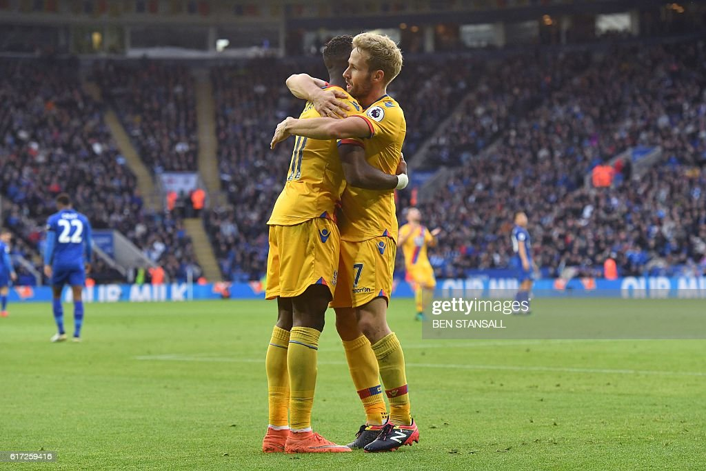Crystal Palace's French midfielder Yohan Cabaye (R) celebrates with Crystal Palace's Ivorian-born English striker Wilfried Zaha after scoring their first goal during the English Premier League football match between Leicester City and Crystal Palace at King Power Stadium in Leicester, central England on October 22, 2016. / AFP / Ben STANSALL / RESTRICTED TO EDITORIAL USE. No use with unauthorized audio, video, data, fixture lists, club/league logos or 'live' services. Online in-match use limited to 75 images, no video emulation. No use in betting, games or single club/league/player publications. /