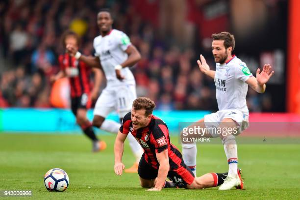Crystal Palace's French midfielder Yohan Cabaye tackles Bournemouth's Scottish midfielder Ryan Fraser during the English Premier League football...